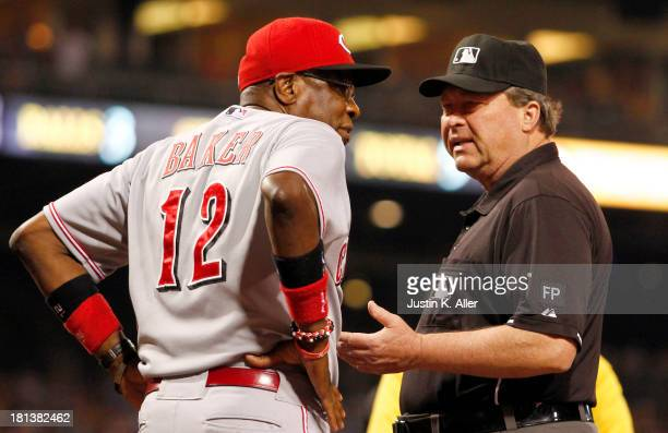 Manager Dusty Baker of the Cincinnati Reds argues with first base umpire Gerry Davis after both teams were warned following Andrew McCutchen of the...