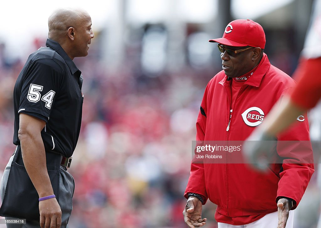 Manager Dusty Baker of the Cincinnati Reds argues with home plate umpire CB Bucknor during the game against the Los Angeles Angels of Anaheim at Great American Ball Park on April 4, 2013 in Cincinnati, Ohio.