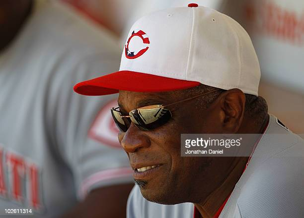Manager Dusty Baker of the Cincinnati Reds smiles while sitting on the bench before a game against the Chicago Cubs at Wrigley Field on July 3, 2010...