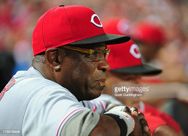 Manager Dusty Baker of the Cincinnati Reds watches the action against the Atlanta Braves at Turner Field on July 12 2013 in Atlanta Georgia