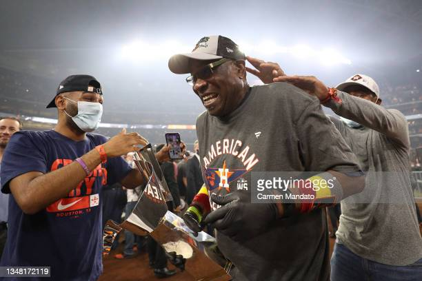 Manager Dusty Baker of the Houston Astros celebrates with the William Harridge Trophy after defeating the Boston Red Sox 5-0 in Game Six of the...