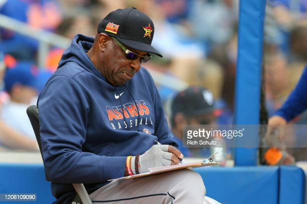 Manager Dusty Baker of the Houston Astros checked his charts during the fifth inning of a spring training baseball game against the New York Mets at...