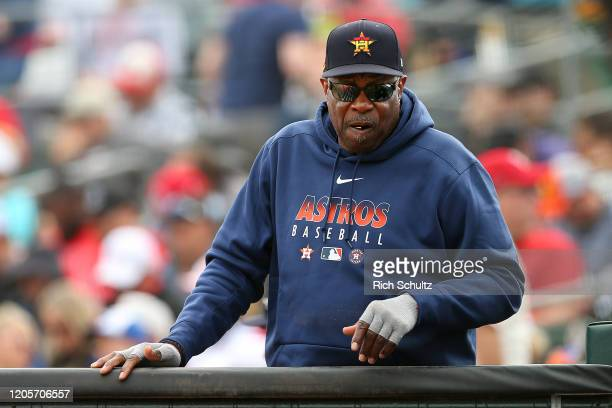 Manager Dusty Baker of the Houston Astros looks into the dugout during a spring training baseball game against the St. Louis Cardinals at Roger Dean...