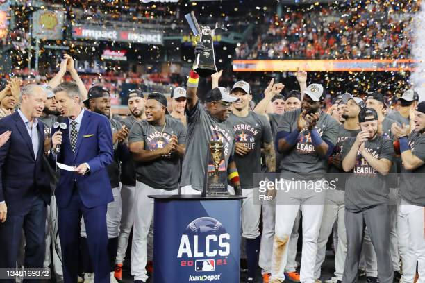 Manager Dusty Baker of the Houston Astros raises the William Harridge Trophy after defeating the Boston Red Sox 5-0 in Game Six of the American...