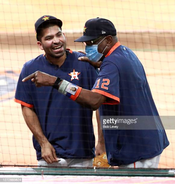 Manager Dusty Baker of the Houston Astros shares a laugh with Jose Urquidy before playing the Texas Rangers at Minute Maid Park on September 16, 2020...