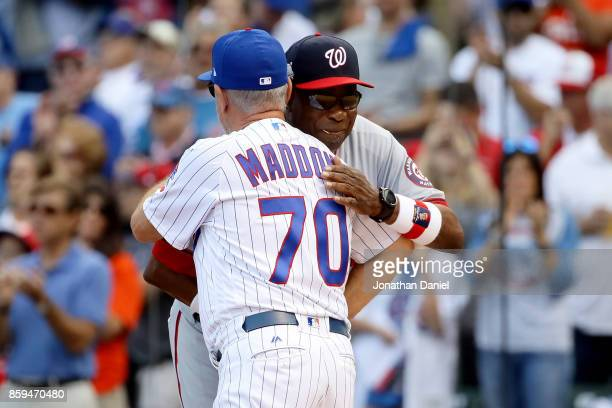Manager Dusty Baker of the Washington Nationals and manager Joe Maddon of the Chicago Cubs meet before game three of the National League Division...