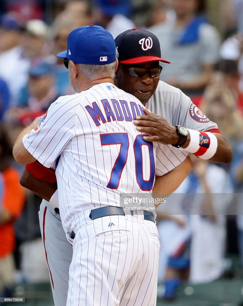 Manager Dusty Baker of the Washington Nationals and manager Joe Maddon of the Chicago Cubs meet before game three of the National League Division Series at Wrigley Field on October 9, 2017 in Chicago, Illinois.