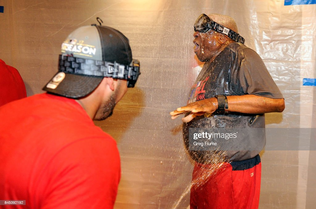Manager Dusty Baker #12 of the Washington Nationals celebrates with players after clinching the National League East after the game against the Philadelphia Phillies at Nationals Park on September 10, 2017 in Washington, DC.