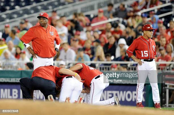Manager Dusty Baker of the Washington Nationals looks on as Bryce Harper is attended to after an injury in the first inning against the San Francisco...