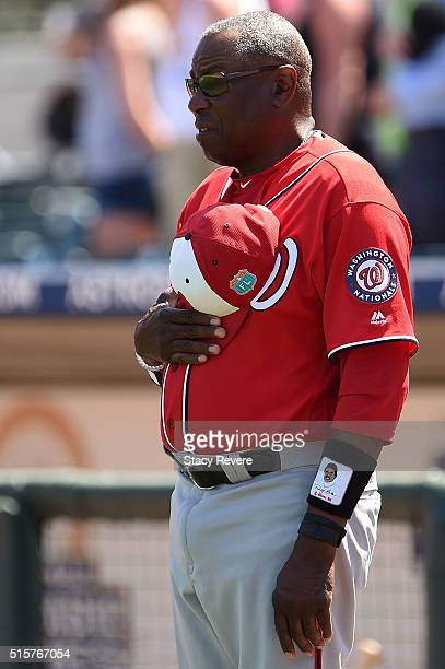 Manager Dusty Baker of the Washington Nationals stands for the National Anthem prior to a spring training game against the Houston Astros at Osceola...