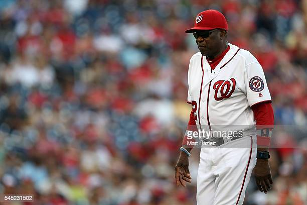 Manager Dusty Baker of the Washington Nationals walks on off of the field in the eighth inning against the Milwaukee Brewers at Nationals Park on...