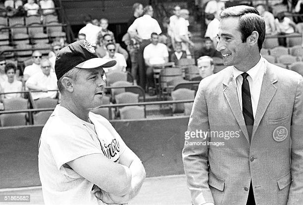 Manager Earl Weaver of the Baltimore Orioles talks with NBC sportscaster and former AllStar pitcher Sandy Koufax prior to a game circa the late...