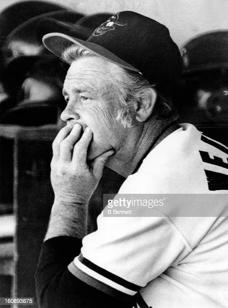 Manager Earl Weaver of the Baltimore Orioles watches from the dugout during a spring training game against the Pittsburgh Pirates on March 18 1973 at...