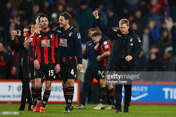 Manager Eddie Howe and Bournemouth players celebrate their 30 win in the Barclays Premier League match between AFC Bournemouth and Norwich City at...