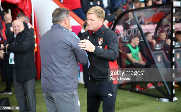 Manager Eddie Howe of Bournemouth welcomes Manager Craig Shakespeare of Leicester City to Vitality Stadium ahead of the Premier League match between...