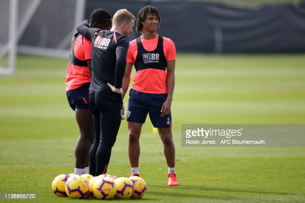 Manager Eddie Howe with Nnamdi Ofoborh and Nathan Ake of Bournemouth during a training session at the Vitality Stadium on March 28 2019 in...