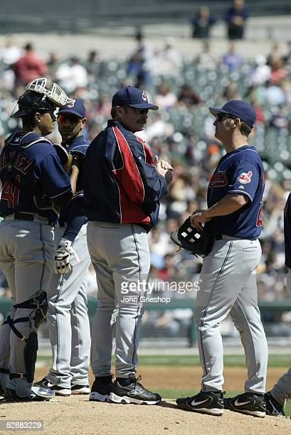 Manager Eric Wedge of the Cleveland Indians meets on the mound with catcher Victor Martinez, third baseman Jose Hernandez, and first baseman Ben...