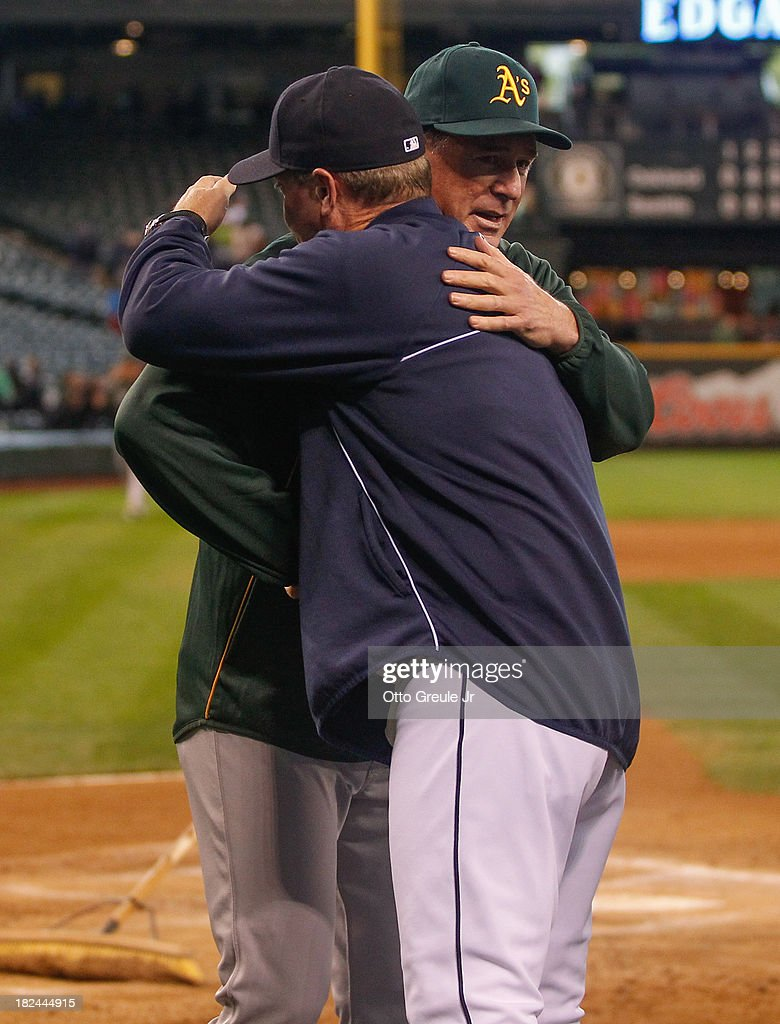 Manager Eric Wedge #22 of the Seattle Mariners gets a hug from manager Bob Melvin #6 of the Oakland Athletics after the Athletics defeated the Mariners 9-0 at Safeco Field on September 29, 2013 in Seattle, Washington.