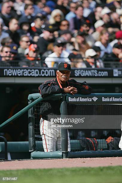 Manager Felipe Alou of the San Francisco Giants watches from the dugout against the Atlanta Braves during the home opener at ATT Park on April 6 2006...