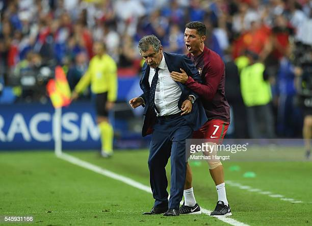 Manager Fernando Santos and Cristiano Ronaldo of Portugal celebrate winning at the final whistle during the UEFA EURO 2016 Final match between...