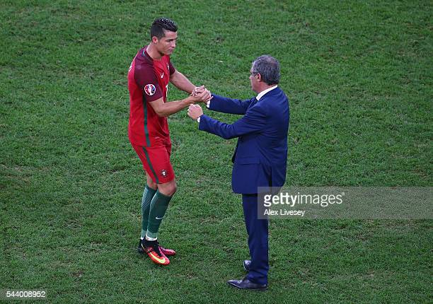 Manager Fernando Santos congratulates Cristiano Ronaldo after the UEFA EURO 2016 quarter final match between Poland and Portugal at Stade Velodrome...