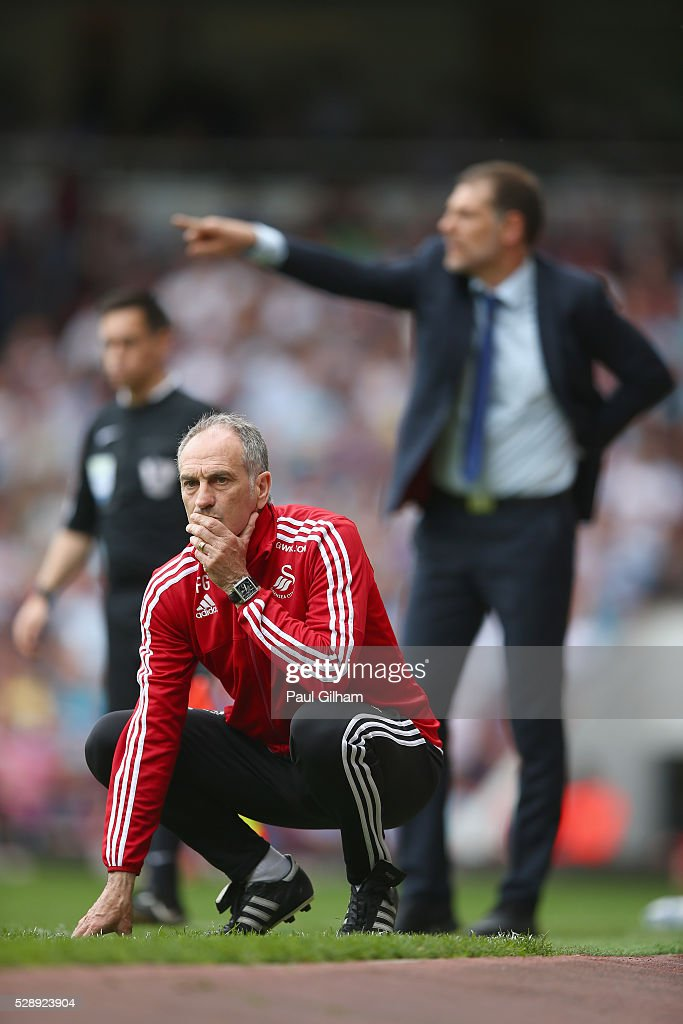 Manager Francesco Guidolin of Swansea looks on as manager Slaven Bilic of West Ham United shouts out from the touchline during the Barclays Premier League match between West Ham United and Swansea City at the Boleyn Ground, May 7, 2016, London, England.