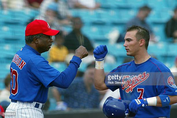 Manager Frank Robinson of the Montreal Expos congratulates Scott Hodges after Hodges hit the game winning homerun against the Los Angeles Dodgers...