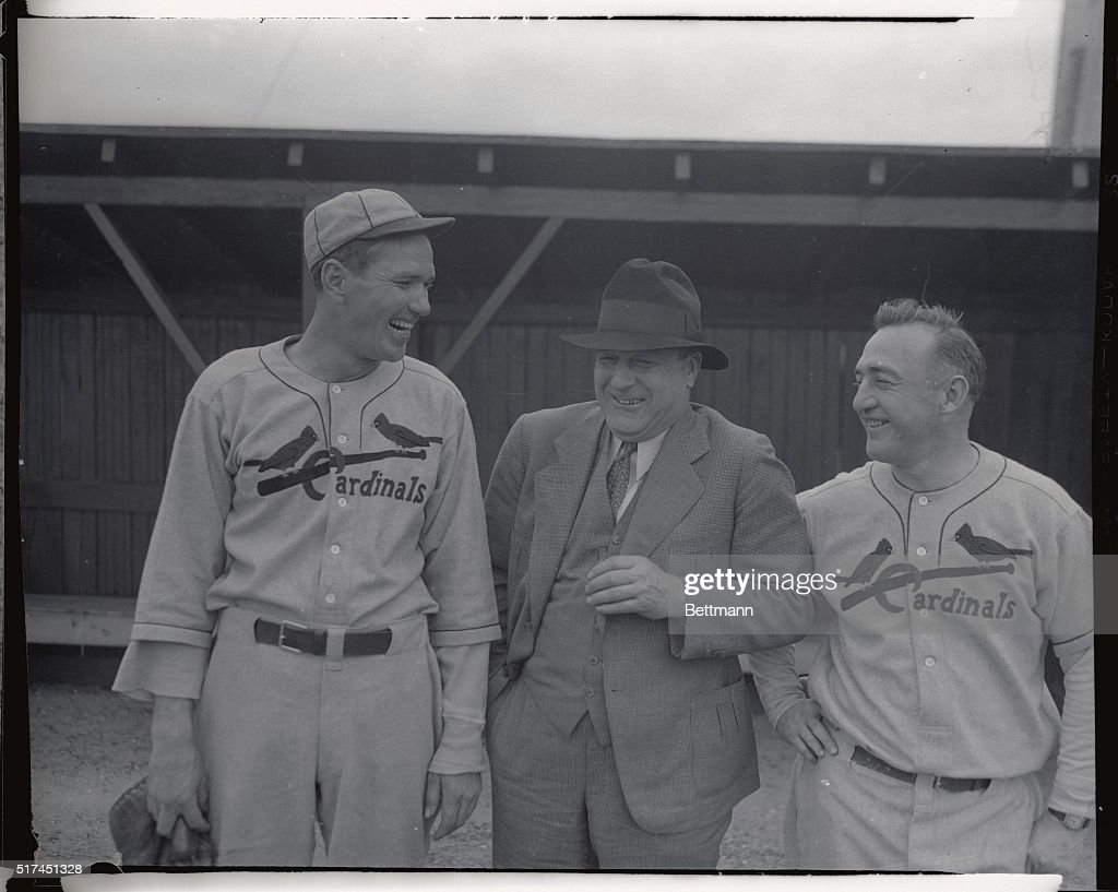 Manager Frankie Frisch (right) of the St. Louis Cardinals, is talking things over with Dizzy Dean (left) and Branch Rickey (center), vice president of the team, at Bradentown, Florida, where the Cards are working out. Dean is the star pitcher of the team.