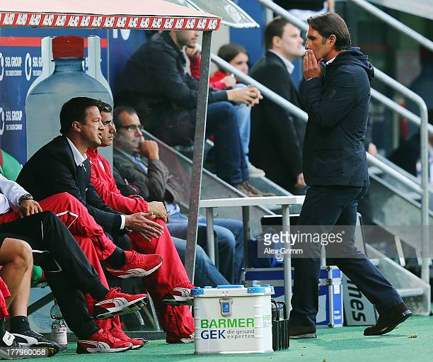 Manager Fredi Bobic assistant coach Eddy Soezer and Bruno Labbadia of Stuttgart react during the Bundesliga match between FC Augsburg and VfB...