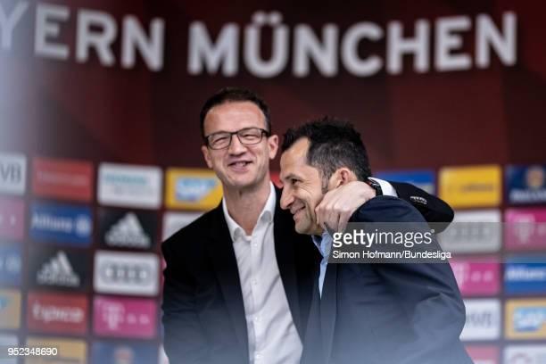 Manager Fredi Bobic of Frankfurt hugs manager Hasan Salihamidzic of Muenchen prior to the Bundesliga match between FC Bayern Muenchen and Eintracht...