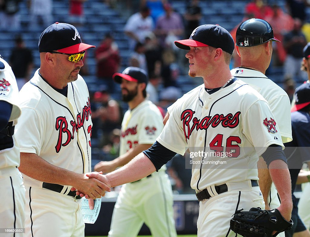 Manager Fredi Gonzalez #33 and Craig Kimbrel #46 of the Atlanta Braves celebrate after the game against the Washington Nationals at Turner Field on June 2, 2013 in Atlanta, Georgia.