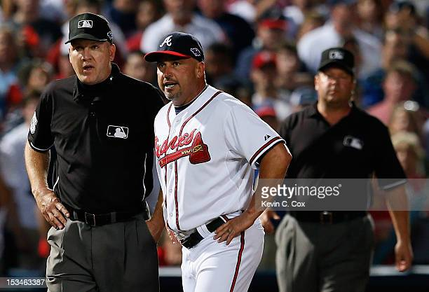 Manager Fredi Gonzalez of the Atlanta Braves argues an infield fly ruling in the eighth inning with third base umpire Jeff Nelson and left field...