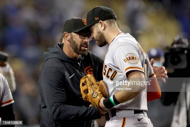 Manager Gabe Kapler celebrates with Evan Longoria of the San Francisco Giants after beating the Los Angeles Dodgers 1-0 in game 3 of the National...