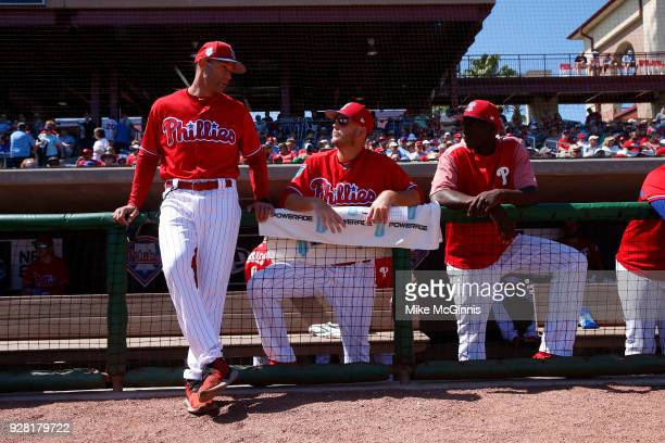 Manager Gabe Kapler of the of the Philadelphia Phillies talks outside the dugout before the Spring training game against the Minnesota Twins at...