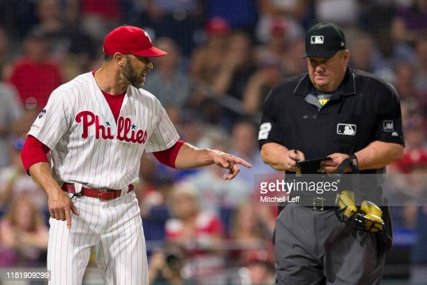 Manager Gabe Kapler of the Philadelphia Phillies argues with umpire Joe West after being ejected in the bottom of the sixth inning against the New...