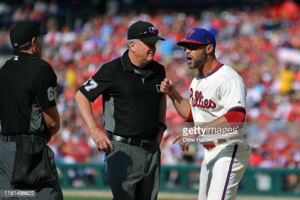Manager Gabe Kapler of the Philadelphia Phillies argues with umpires Chris Guccione and Mike Everitt in the fourth inning during the game against the...