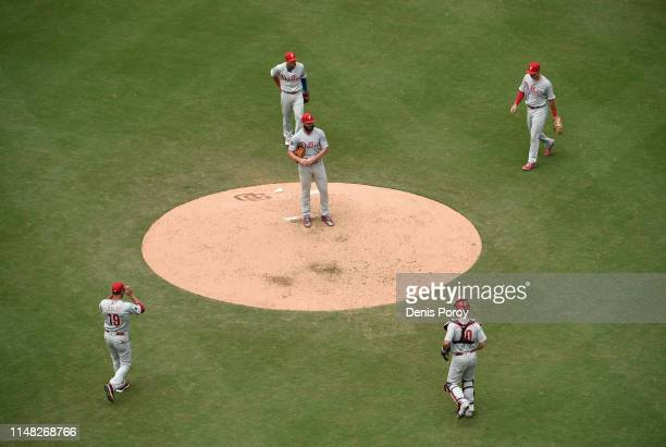 Manager Gabe Kapler of the Philadelphia Phillies comes onto the field to take Jake Arrieta out of the game during the sixth inning of a baseball game...