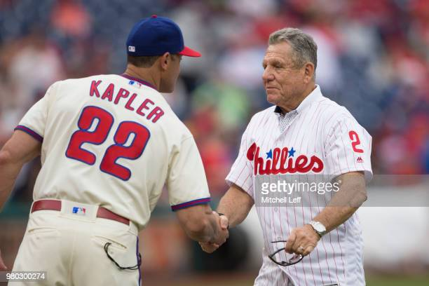 Manager Gabe Kapler of the Philadelphia Phillies shakes hands with former Philadelphia Phillies player Larry Bowa prior to the game against the...