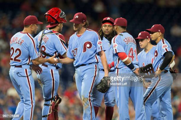 Manager Gabe Kapler of the Philadelphia Phillies takes Aaron Nola out of the game as Jorge Alfaro Maikel Franco Carlos Santana Scott Kingery and...