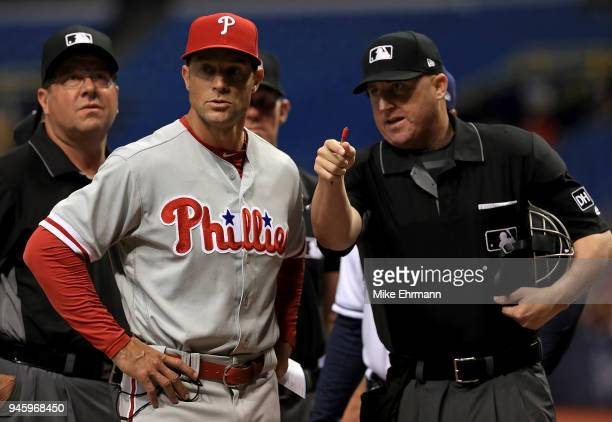 Manager Gabe Kapler of the Philadelphia Phillies talks with home plate umpire Ryan Blakney 6during a game against the Tampa Bay Rays at Tropicana...