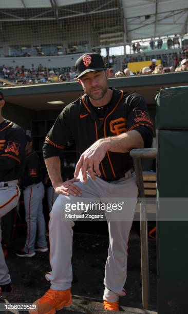 February 23: Manager Gabe Kapler of the San Francisco Giants stands in the dugout during the game against the Oakland Athletics at Hohokam Stadium on...
