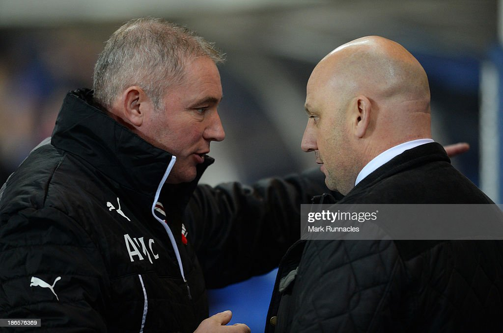 Manager Gary Bollan of Airdrieonians talks to manager Ally McCoist of Rangers during the The William Hill Scottish Cup Third Round match between Rangers and Airdrieonians at Ibrox Stadium on November 1, 2013 in Glasgow, Scotland.