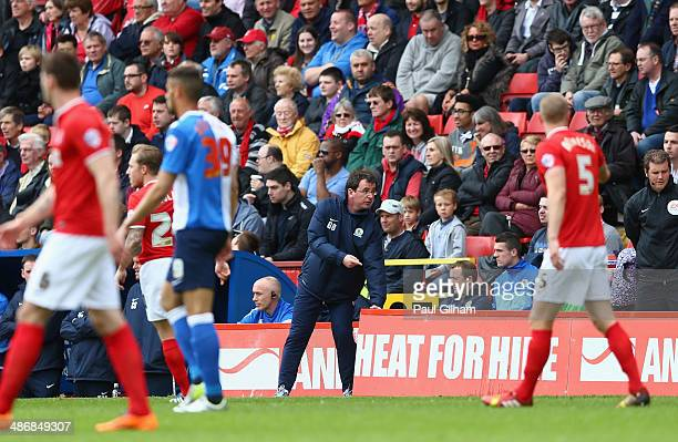 Manager Gary Bowyer of Blackburn Rovers tries to mve the advertising hoardings after a player fell into them during the Sky Bet Championship match...
