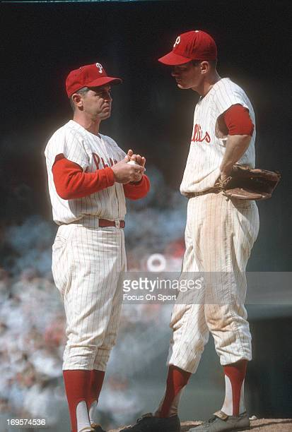 Manager Gene Mauch of Philadelphia Phillies on the mound talking with his pitcher during an Major League Baseball game circa 1964 at Connie Mack...