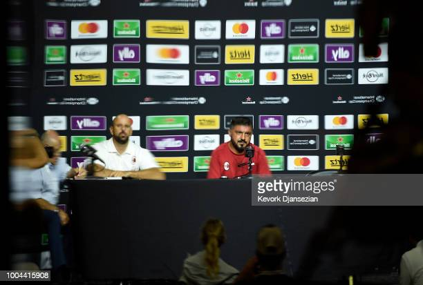 Manager Gennaro Gattuso of AC Milan's reflection is seen on a window during a news conference after a preseason training session StubHub Center on...
