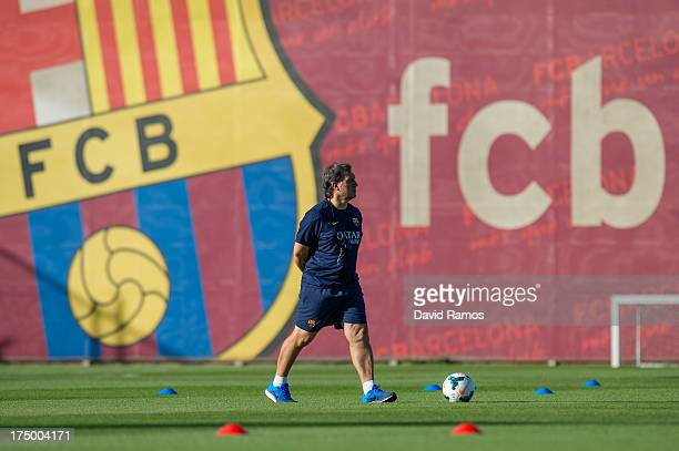 Manager Gerardo 'Tata' Martino of FC Barcelona looks on during a training session at the Sant Joan Despi Sport Complex on July 29 2013 in Barcelona...