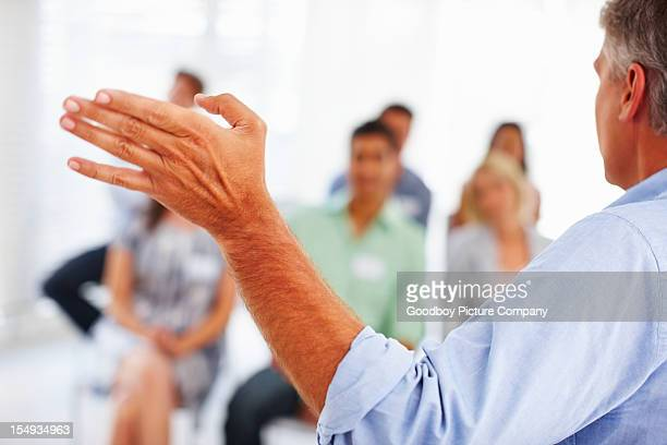 Manager giving presentation to business people