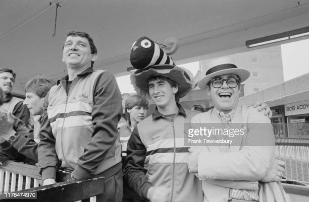 Manager Graham Taylor , soccer player Nigel Callaghan, and English singer Elton John, chairman of Watford FC, ahead of the FA Cup Final match, UK,...