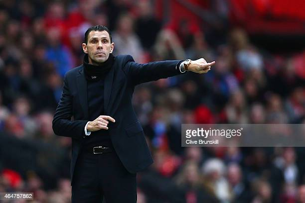 Manager Gustavo Poyet of Sunderland gives instructions during the Barclays Premier League match between Manchester United and Sunderland at Old...