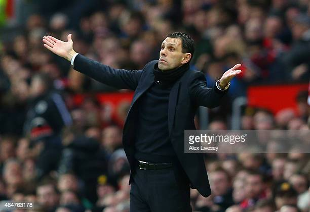 Manager Gustavo Poyet of Sunderland reacts uring the Barclays Premier League match between Manchester United and Sunderland at Old Trafford on...